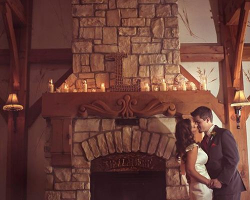 Bellamere Winery London Ontario Wedding Venue First Kiss Love Fire Place Winter Wedding Candles Silk Dress Ceremony Location