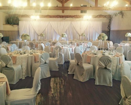 Bellamere Winery London Ontario Wedding Venue Rustic Barn Venue Romantic White and Pink Chair Covers Backdrop