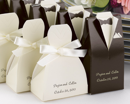 Bride favour boxes as a white dress and black tux groom favour boxes. With couples name and date written on them.