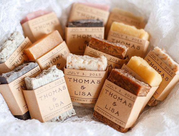 Different handmade soaps are covered with custom printed card stock paper.