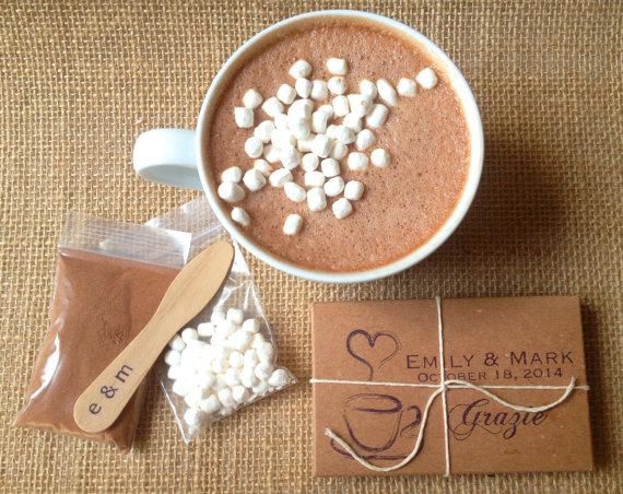 A hot chocolate wedding favour idea. The mix, mini marshmallows, embossed stir stick and custom logo package.