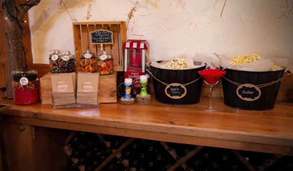 Popcorn and candy bar with paper favour bags. Setup on the grand hall platter station.